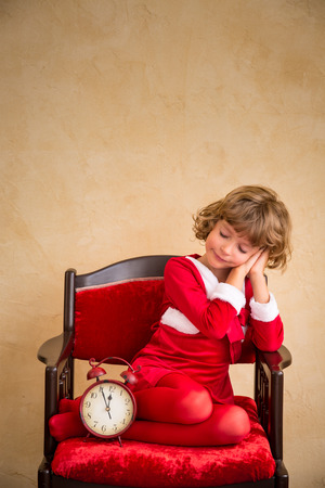 miracle tree: Child sleeping in armchair. Christmas gift. Xmas holiday concept