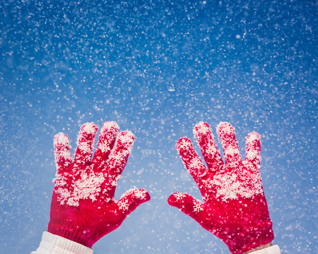 red gloves: Winter Hand Red Gloves Snow Snowy Blue Sky Background Stock Photo