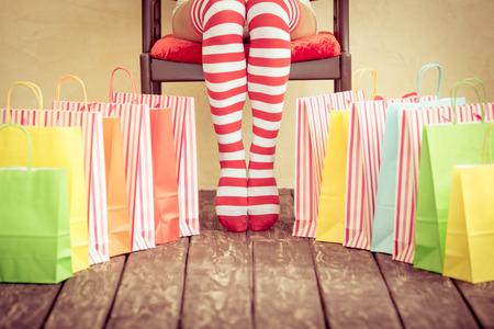 sexy santa: Sexy Santa woman legs. Christmas shopping concept