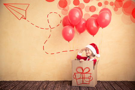 kid portrait: Child playing at home. Christmas gift. Xmas holiday concept