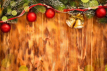 christmas lights background: Christmas tree branch with decorations on wood background. Xmas holiday concept Stock Photo