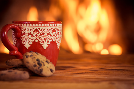 Christmas ornament near fireplace. Winter holiday concept