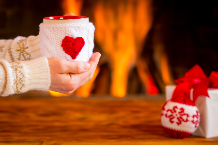 snug: Woman near fireplace. Valentines day at home. Winter holiday concept Stock Photo