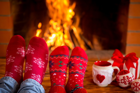 snug: Couple near fireplace. Valentines day at home. Winter holiday concept Stock Photo