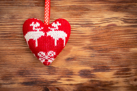 heart background: Valentines day ornament on wood background. Winter holiday concept