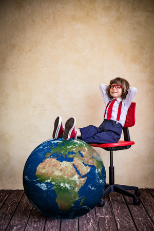 Portrait of young businessman kid in office. Global business concept. Stock Photo