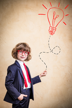 Portrait of child businessman in office. Success, creative and idea business concept