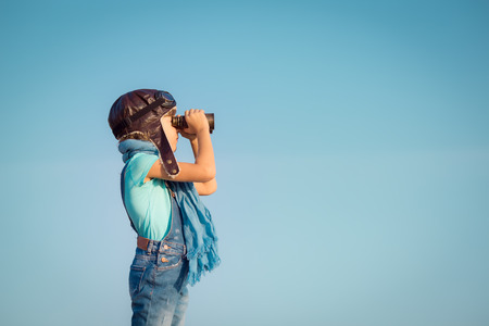 spyglass: Happy kid playing outdoors. Travel and adventure concept Stock Photo