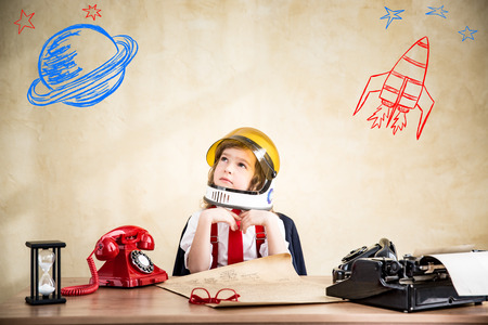 spacesuit: Portrait of child businessman in astronaut spacesuit. Start up business concept Stock Photo