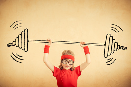 nerd: Funny nerd kid with drawn barbell. Success and winner concept