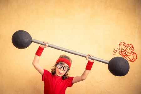 girl sport: Funny strong child with barbell. Girl power and feminism concept. Sport fitness kid