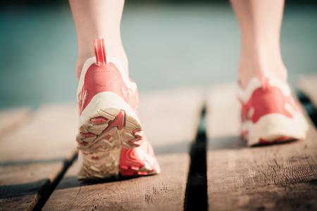summer sport: Feet of jogging woman. Summer sport concept