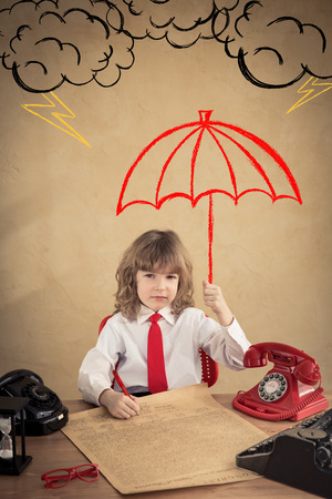 child protection: Portrait of child businessman in office. Business protection concept