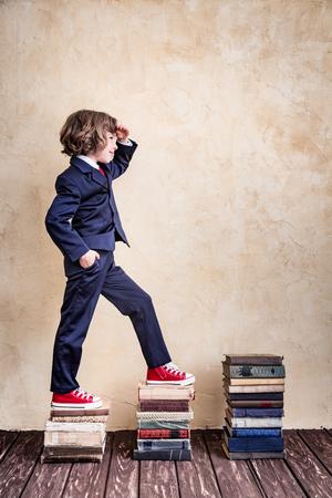 schoolchild: Happy schoolchild in class. Knowledge is power concept