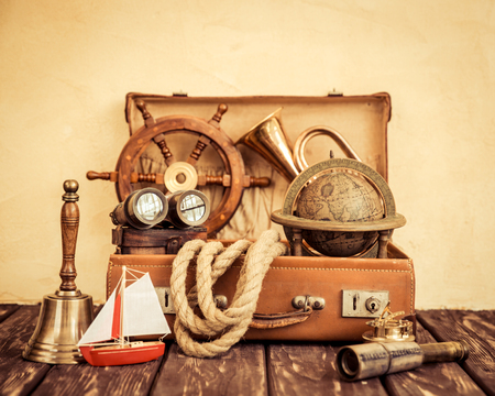 vintage travel: Vintage nautical items in suitcase. Travel and summer vacation concept