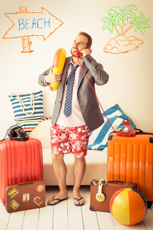 Funny businessman ready for a summer vacation. Man having fun at home Stock Photo