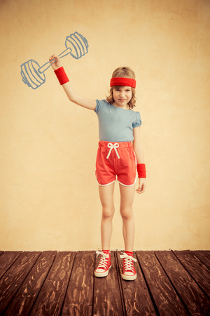 geek: Funny strong child with drawn barbell. Girl power and feminism concept. Sport fitness kid