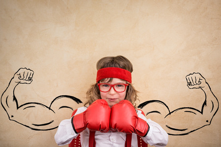 female boxing: Funny winner child. Success, leader and business concept