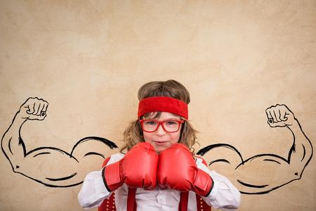 à  à     à  à    à  à female: Niño divertido ganador. Éxito, líder y concepto de negocio Foto de archivo