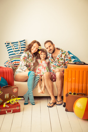 family vacation: Happy family ready for a summer vacation. Father, mother and child having fun at home