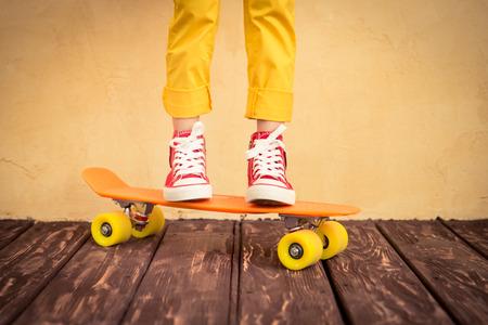 boy kid: Legs of skateboarder. Closeup view Stock Photo