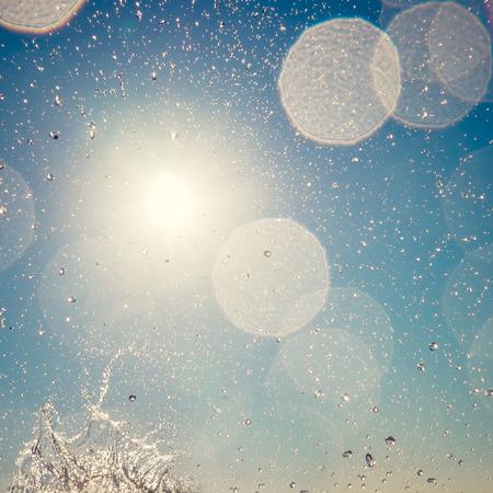 Summer sky bokeh. Abstract blurred water splash background