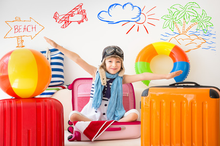 Happy child ready for a summer vacation. Kid having fun at home