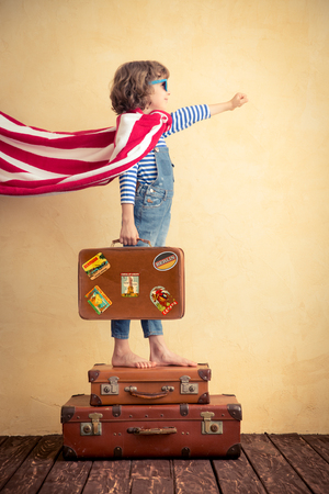 Superhero child ready for a summer vacation. Kid having fun at home Stock Photo