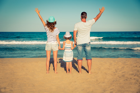 open hands: Happy family having fun on the beach. Summer vacation and travel concept Stock Photo