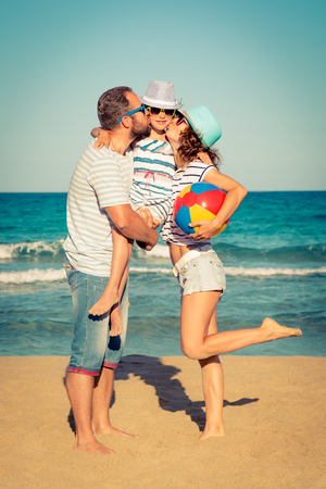 Happy family having fun on the beach. Summer vacation and travel concept Stock Photo