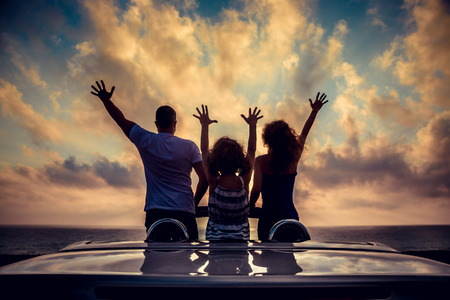 people relaxing: Silhouette of family relaxing on the beach. People having fun in cabriolet against blue sky background. Summer vacation and travel concept