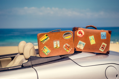 cabriolet: Vintage suitcases on cabriolet car. Summer vacation and travel concept