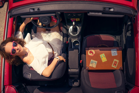 cabrio: Happy woman travel by car. Girl having fun in red cabriolet. Summer vacation and travel concept. Top view