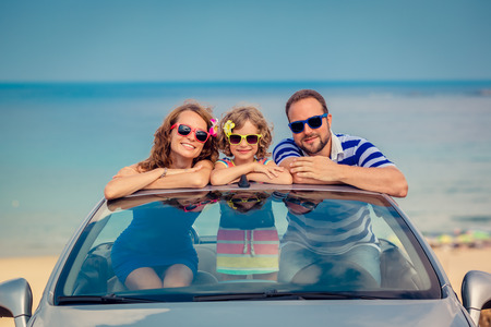 Happy family travel by car to the sea. People having fun in cabriolet. Summer vacation concept 版權商用圖片