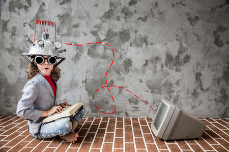 Portrait of young child pretent to be businessman. Kid with toy virtual reality headset in modern loft office. Success, creative and innovation technology concept. Copy space for your text