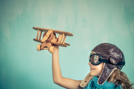 freedom concept: Child pilot. Kid playing at home. Freedom and travel concept. Dream and imagination