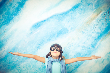 pilot light: Child pilot. Kid playing at home. Freedom and travel concept. Dream and imagination