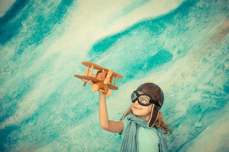 Child pilot. Kid playing at home. Freedom and travel concept. Dream and imagination