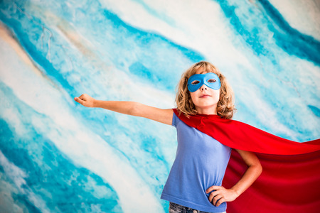 Superhero child. Kid super hero. Freedom, winner and success concept. Dream and imagination