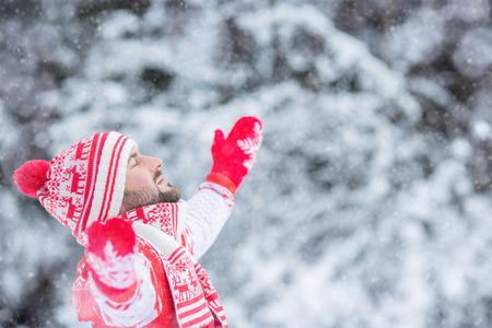 winter park: Happy man having fun in winter park Stock Photo