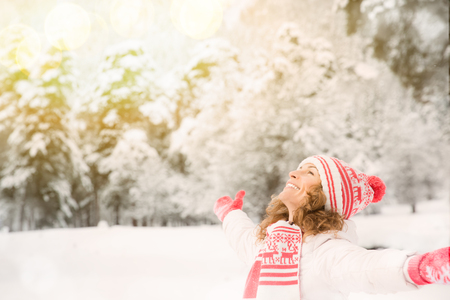Happy woman playing outdoors. Girl having fun in winter park Stock Photo