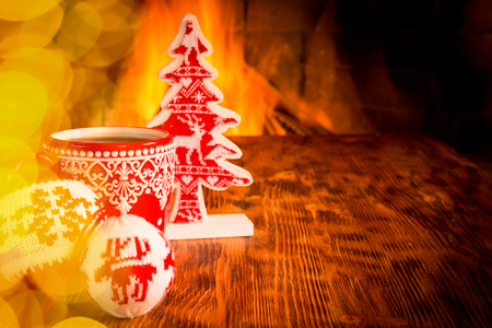 Christmas decoration near fireplace. Winter holiday Xmas and New Year concept