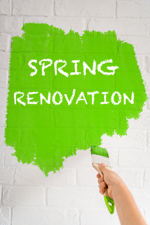 painting: Child painting on the brick wall. Spring renovation and design concept Stock Photo