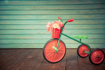 Vintage bike with bouquet of tulips against wood background. Womans day. 8 March. Spring holiday concept Stock Photo