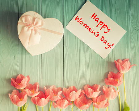 Top view of tulips on wood table. Womans day. 8 March. Spring holiday concept