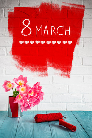 blue wall: Bouquet of tulips on wood table. Womans day. 8 March. Spring holiday and home renovation concept Stock Photo