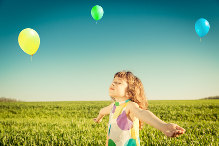 aspirational: Happy child outdoors against blue sky background. Stock Photo