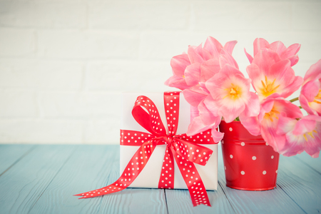 Bouquet of tulips on wood table. Womans day. 8 March. Spring holiday and home renovation concept Stok Fotoğraf