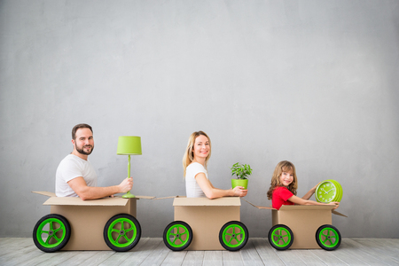 delivery room: Happy family playing into new home. Father, mother and child having fun together. Moving house day and express delivery concept Stock Photo