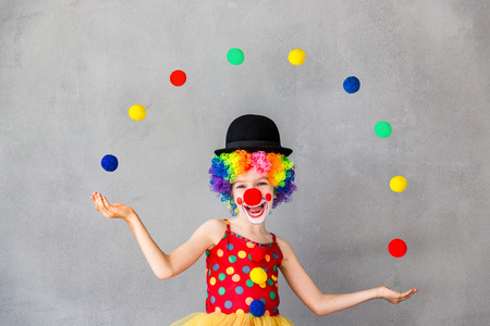Funny kid clown. Child playing at home. 1 April Fool's day concept Stock fotó - 74006281